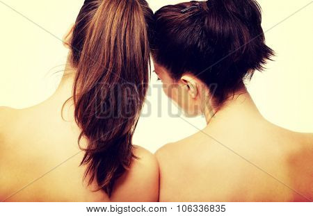 Two attractive topless women with beautiful hair.