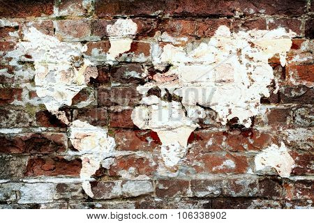 Brick Wall And A Picture Map Of The World