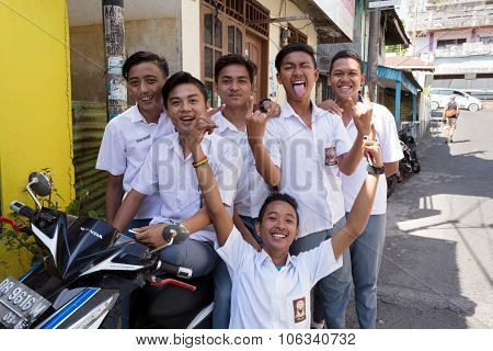 Young Happy Muslim Students In White Uniform