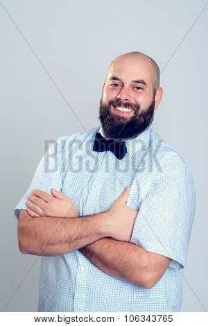 Young Bearded Man In Blue Shirt And Bow Tie