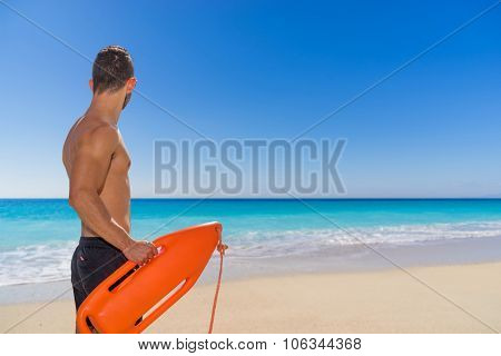lifeguard on duty keeping a buoy at the beach