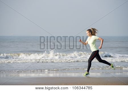Female Running By The Sea