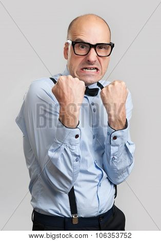 Angry Guy With Suspenders And Bow-tie