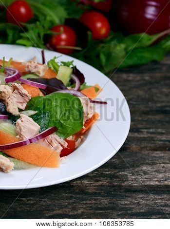 Tuna Salad With Spinach, Rocket, Red Ruby Chard, Tomatoes, Cucumbers, Carrot, Red Onion On Old Woode