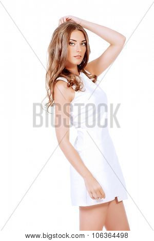 Beautiful young woman in white dress smiling at camera. Isolated over white background. Beauty, fashion. Cosmetics.