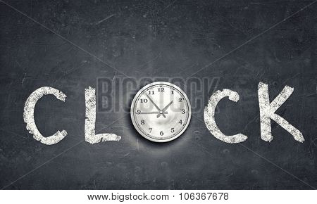 Conceptual image with word clock on gray background