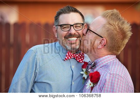Smiling Man Kissed By Spouse