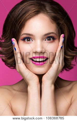 Beautiful Model Girl With Bright Pink Makeup, Smile And Colored  Nail Polish. Beauty Face. Short