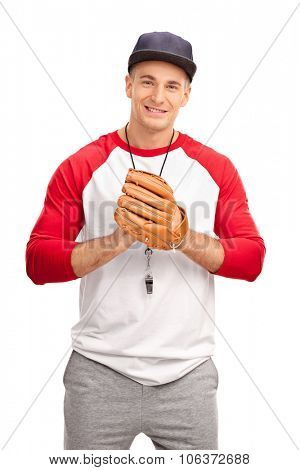 Young baseball coach with a baseball glove looking at the camera isolated on white background