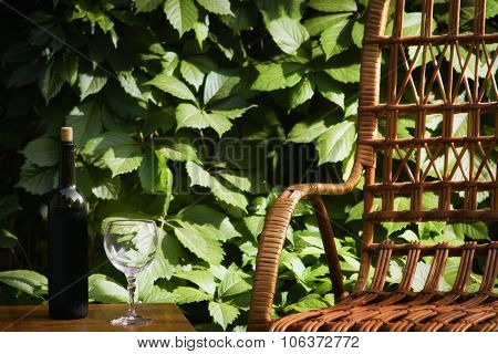 Wicker Chair And Bottle Of Wine
