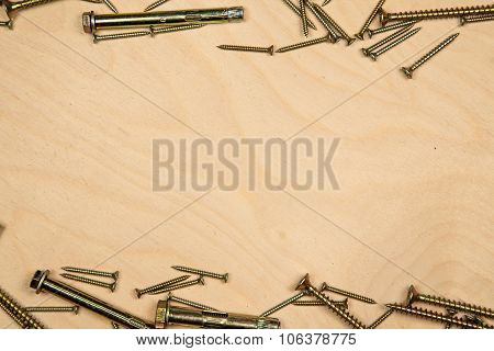 Gold screws on bottom and top with wood background