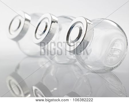 Glass jar for condiment with lid on white background