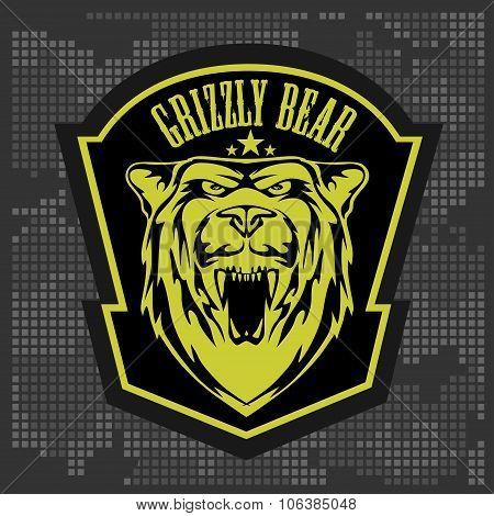 Grizzly bear head emblem.