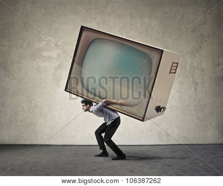 Man carrying a giant tv