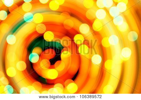 Rotary motion bokeh background of bright orange lights