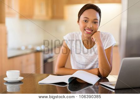 portrait of pretty female african college student studying at home