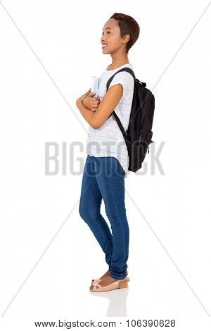side view of young african college student looking up isolated on white