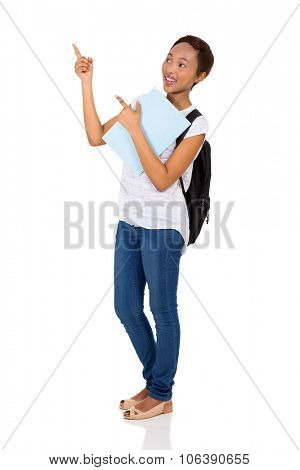 cheerful young african university student pointing on white background