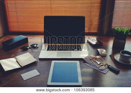 Digital tablet and laptop computer hipster office workplace desktop