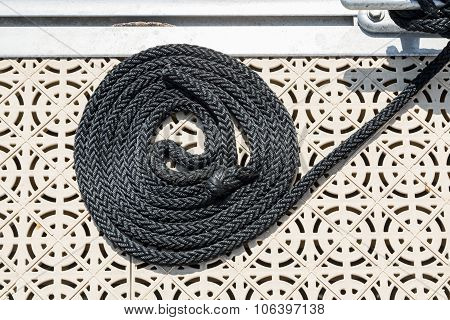 The Braided Mooring Rope On A Ship Deck. Nautical Mooring Rope