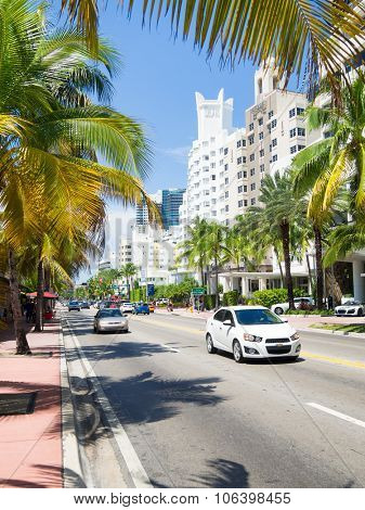MIAMI,USA - AUGUST 8,2015 : Street scene with traffic and  famous hotels at Collins Avenue in Miami Beach