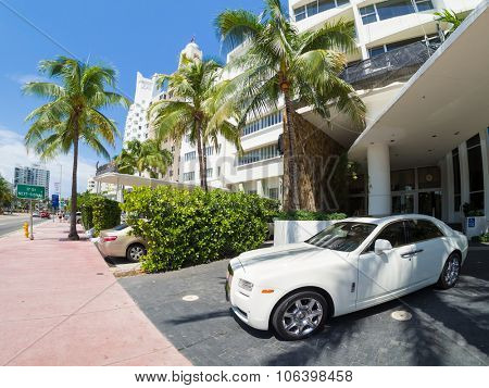 MIAMI,USA - AUGUST 8,2015 :  Rolls Royce luxury car next to a famous hotel at Miami Beach