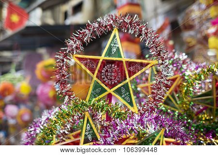 Colorful star shaped lantern for sale on an old street of Hanoi
