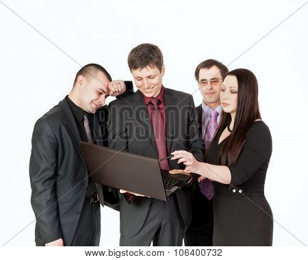 Four Businessmen Near Laptop On Business Talk