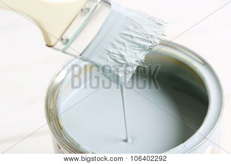 White paint on the wooden table