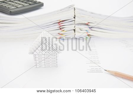 Brown Pencil And House On Balance Sheet