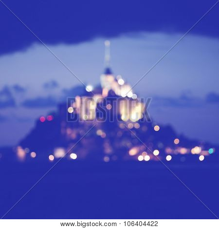 Defocused image of Mont Saint Michell at twilight. Normandy. France.