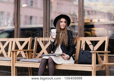 Young hipster girl enjoying c while resting after work on laptop computer