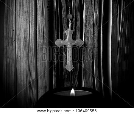 Candle With Cross And Bible On Table
