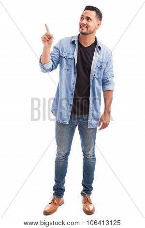 Guy Pointing And Looking Up In A Studio