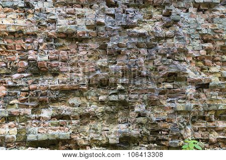 Old Dilapidated Brick Wall .