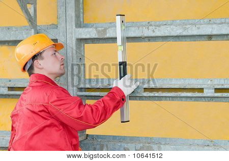 Builder With Digital Level