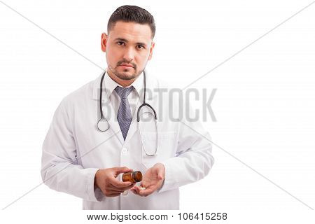 Doctor Taking Some Pills From A Bottle