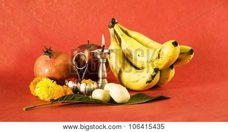 hindu puja elements, diya, haldi kumkum,fruits like apple, pomegranate and banana as offering to god