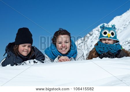 Happy family in the snow - enjoying the winter, portrait in the mountains