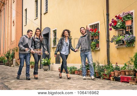 Young Tourists Walking In The Old Town At A Free Walk Tour