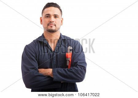 Portrait Of A Plumber In Overalls