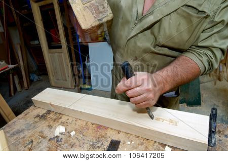 Forefront of the hands of a carpenter working.