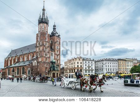 Saint Mary Basilica and Main Square in Krakow. Poland. 6 May 2015.