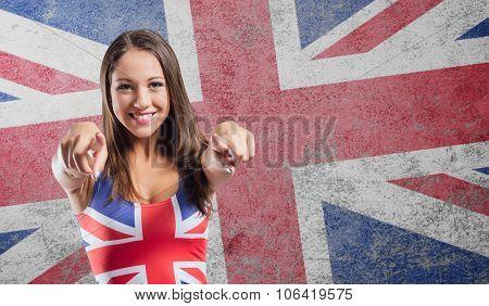 Smiling Girl Pointing At Camera