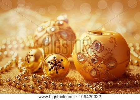 Christmas ball with jingle bells in golden tone with glittering background