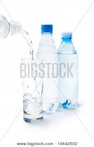 Drinking Water In The Glass And Bottles