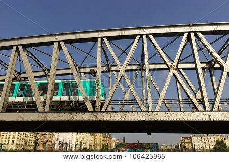 PARIS, FRANCE - AUGUST 10, 2015: view on subway bridge in Paris. Paris is the capital and most-populous city of France. Situated on the Seine River, in the north of the country