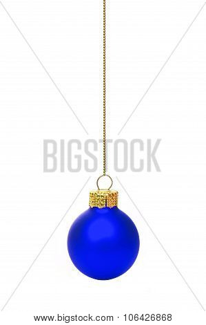 Hanging blue Christmas ornament over white