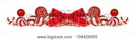 Red and white Christmas baubles, bows and candy cane border
