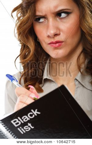 Businesswoman Writing A Black List
